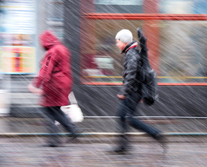 People walking down the street in a snowy winter day