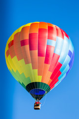 single colorful hot air balloon in flight