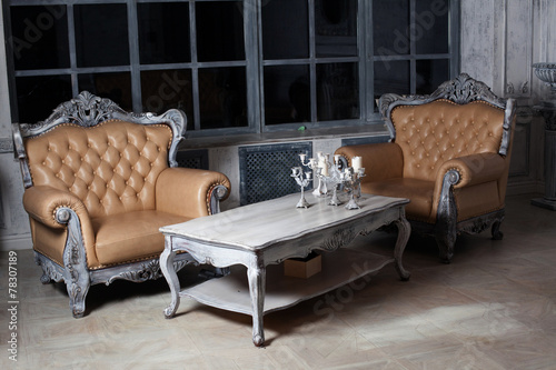 two chairs and a table in the style of furniture garnirur - 78307189