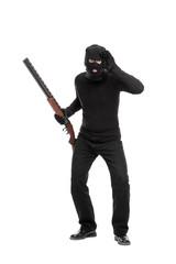 Burglar with rifle looking through an imaginary glass