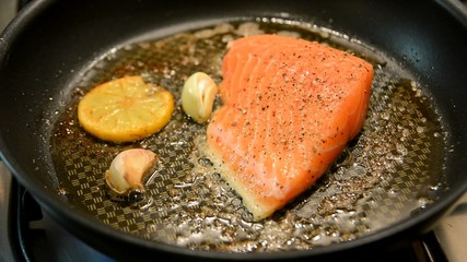 Fresh salmon steak fry in a pan.