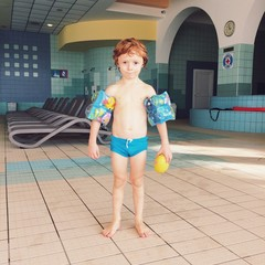Young boy at the swimming pool
