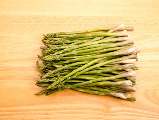 Bunch of Asparagus on Wood Cutting Board