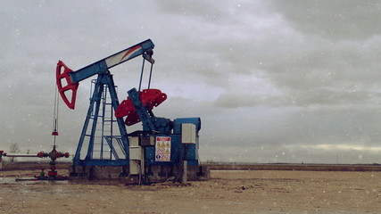 Pumpjack Oil Pump operating on natural gas in the field pumping