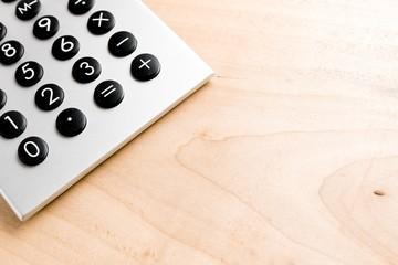 classica calculator on wooden desk