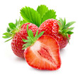 Two strawberries and a half closeup on white background
