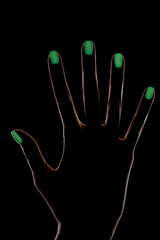 Female hand silhouette with phosphorescent nail polish