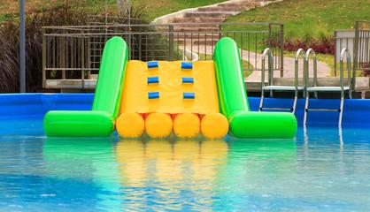 plastic slider in  swimming pool - Stock Image