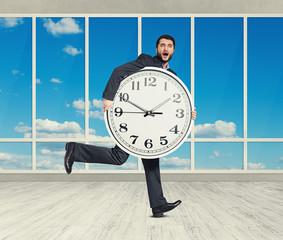 amazed man with big white clock