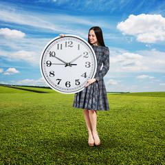 attractive woman looking at clock
