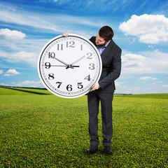 man looking at big clock at outdoor