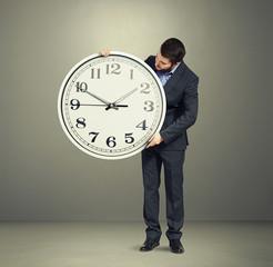 man looking at clock dial