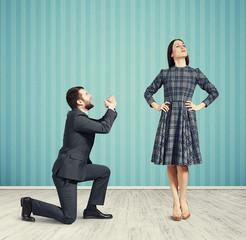 man looking at woman and asking
