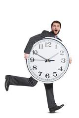 scared man holding big clock