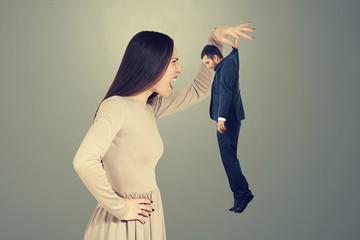 screaming woman looking at small man