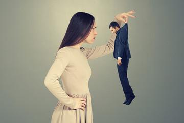 woman scrutinizing small man