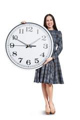 woman with big clock posing