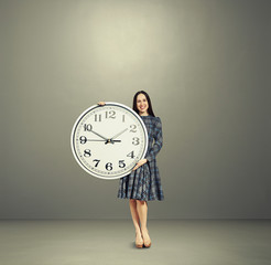 woman with big white clock