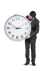 young businessman with big clock