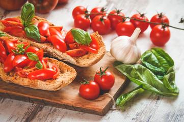 Italian starter, bruschetta with Sicilian red fresh tomato on a
