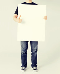 man showing white blank board and thumbs up