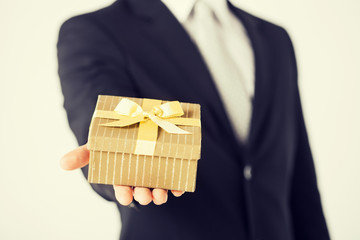 man hands holding gift box