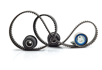 Timing belt, two rollers and the tension mechanism