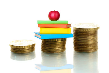 Apple and books standing on stack of coins isolated on white