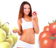 Beautiful young woman with apple and tomato in hands isolated