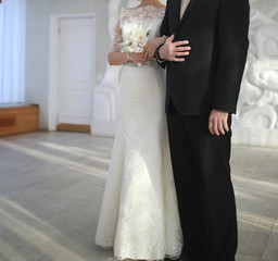 Жених и невеста во дворце бракосочетания