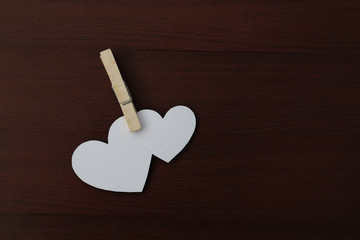 two white paper heart and clip