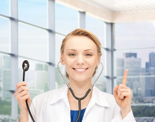 happy female doctor with stethoscope