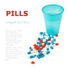 Pills and glass of water isolated on white