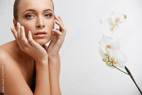 Poster Spa Woman. Beautiful Girl Touching Her Face. Perfect Skin.