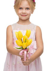 Close up picture of little girl with yellow tulips