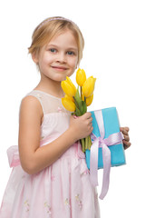 Girl holding bouquet of yellow tulips and present box