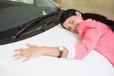 Smiling woman hugging a white car poster