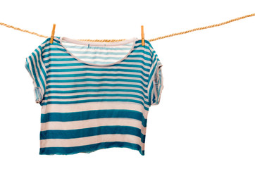 blue tshirt hanging on a rope clothesline