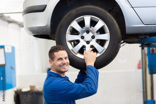 Mechanic adjusting the tire wheel