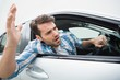 canvas print picture - Young man experiencing road rage
