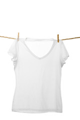 white tshirt hanging on a rope clothesline