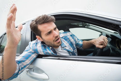 canvas print picture Young man experiencing road rage
