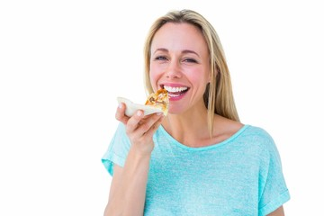 Smiling blonde eating slice of pizza