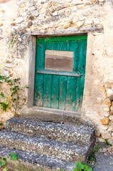 Old colored door on a stone facade