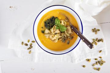 Pumpkin cream soup with cheese tortellini