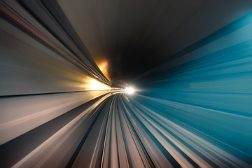 Subway tunnel with blurred light tracks in underround gallery