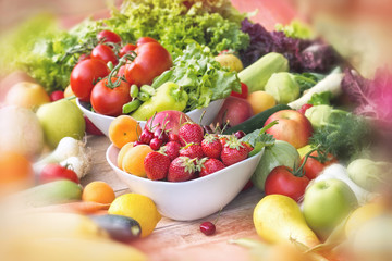 Fresh organic fruits and vegetables on table