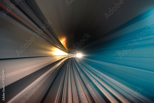 Subway tunnel with blurred light tracks in underround gallery - 78320945