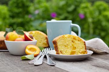 Freshly baked peach cake with tea