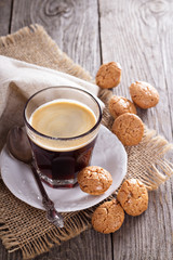 Black coffee in a glass with almond cookies